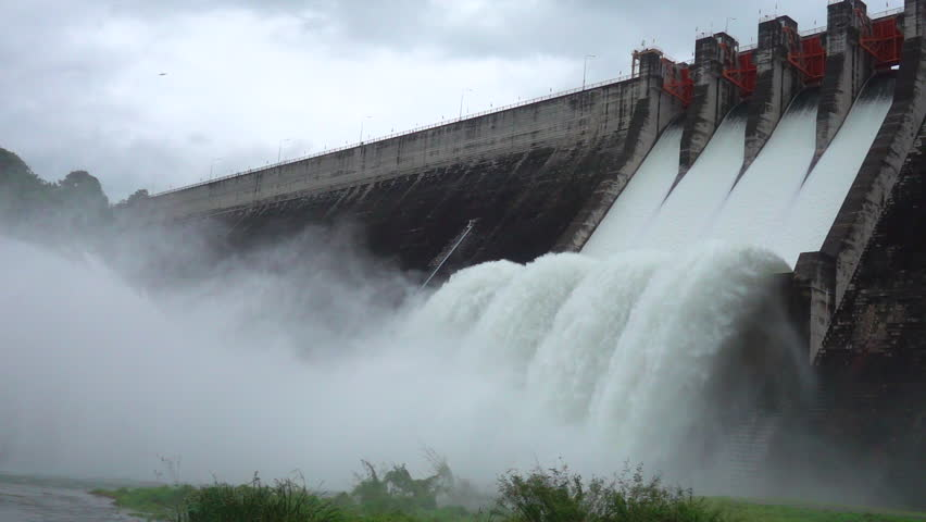 Slow motion of water dam drained from outlet pipe of the dam where is the hydropower electrical generation
