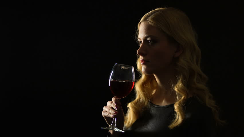 Sexy woman drinking glass of wine isolated on black background, night party | Shutterstock HD Video #1026840596