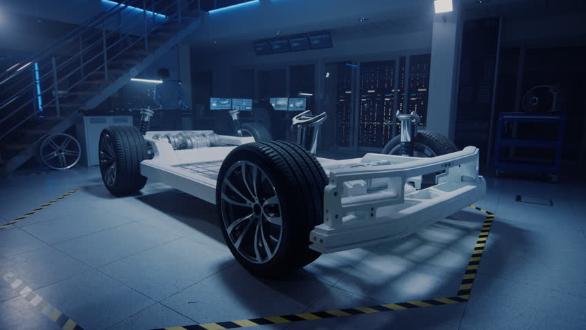 Concept of Authentic Electric Car Platform Chassis Prototype Standing in High Tech Industrial Machinery Design Laboratory. Hybrid Frame include Tires, Suspension, Engine and Battery. #1026842681