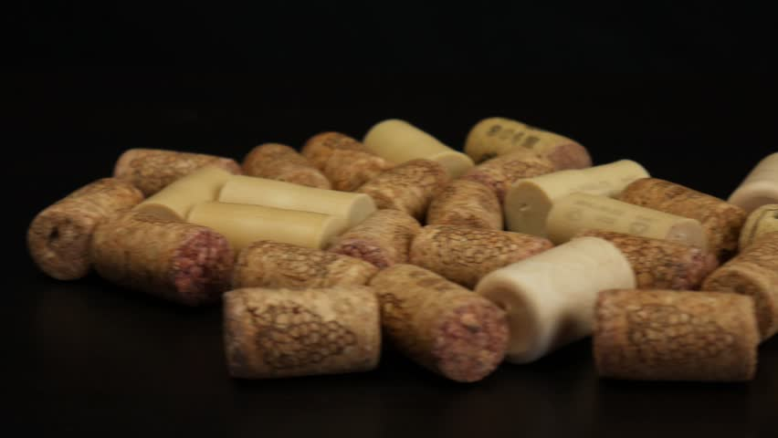 Close up of wine corks on black table. Camera moves from right to left | Shutterstock HD Video #1026870131