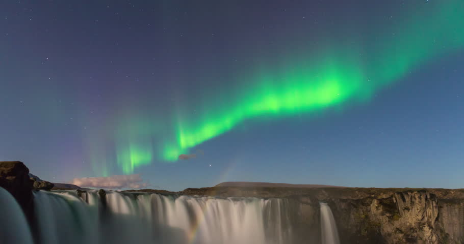 Timelapse of amazing northern lights over waterfall in Iceland