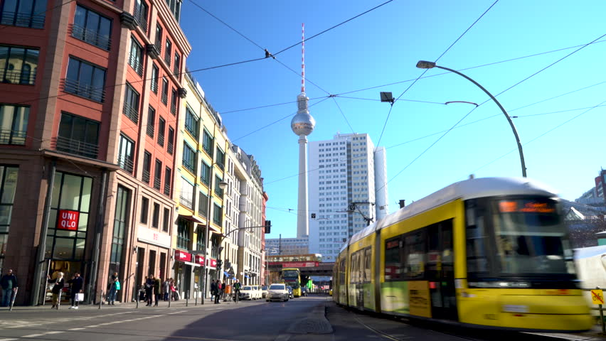 HACKESCHER MARKT, BERLIN, GERMANY – 16 FEBRUARY 2019: Trains, trams, bus and people in Hackescher Markt near the Berliner Fernsehturm Television Tower, Berlin, Germany