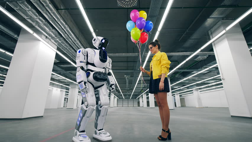 Woman gives balloons as a present to her friend droid. | Shutterstock HD Video #1026880436