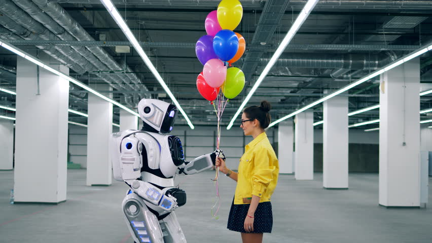 Young woman gives many colorful balloons to her friend cyborg. | Shutterstock HD Video #1026880490