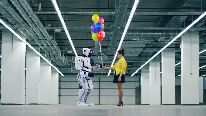 A woman gives bunch of balloons to a white droid. | Shutterstock HD Video #1026880496