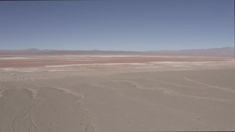 Aerial, Salar De Pocitos, Argentina - flat version. This clip is available in three different gradings - native 10Bit HLG (H265) or flat, cine grading and neutral grading.