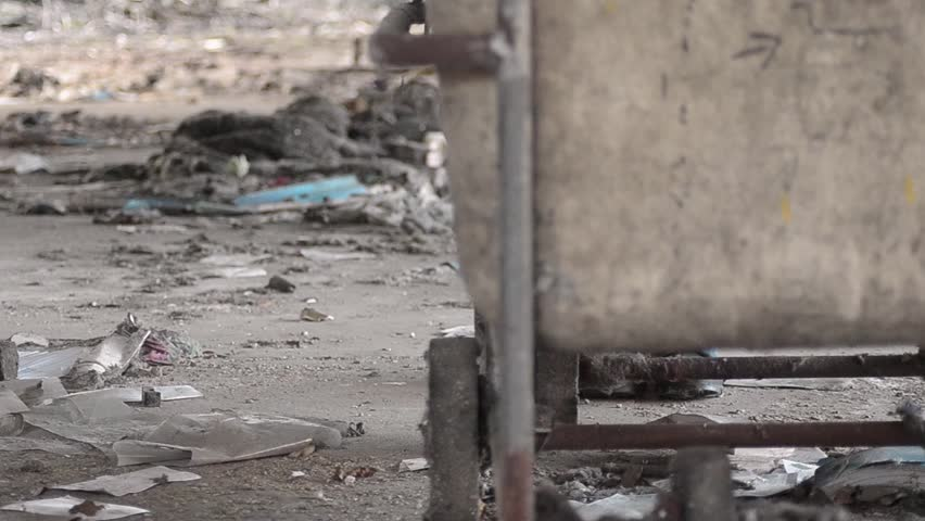 Pulling a cart through rubble in abandoned derelict mill