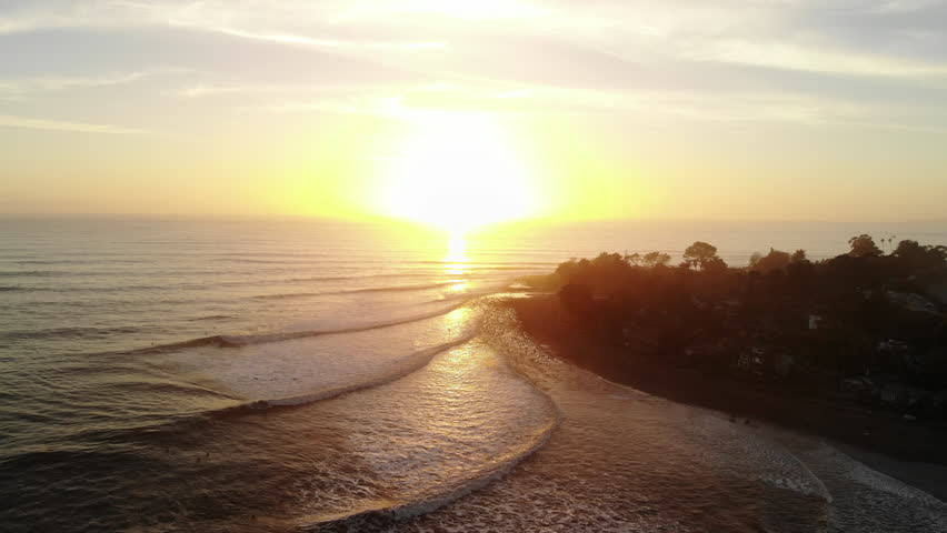Aerial drone at Rincon Point beach surf break with ocean waves and people surfing at sunset on the beautiful California coastline. | Shutterstock HD Video #1026884921