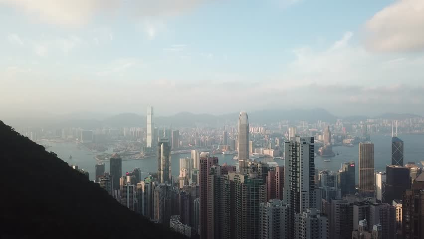 Sunset in Hong Kong. Aerial shot of mountains and skyscrapers. | Shutterstock HD Video #1026886055