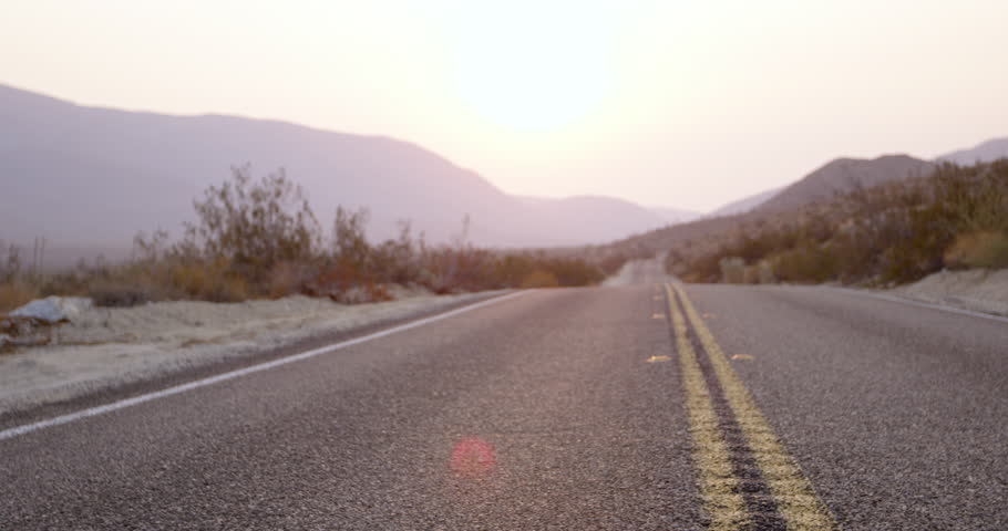 Young stylish woman walks down center of desert highway - young hippy adventure | Shutterstock HD Video #1026889637