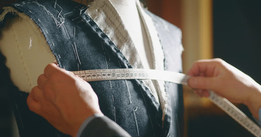 Slow motion of tailor taking a measures  for a new handmade great quality suit  in atelier. | Shutterstock HD Video #1026909266
