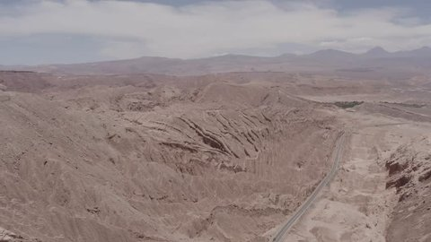 Aerial, Valle De La Luna, Atacama Desert, Chile - flat (HLG). This clip is available in three different gradings - native 10Bit HLG (H265) or flat, cine grading and neutral grading.