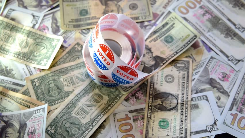 Zoom in on a roll of I Voted Today stickers on dollar bills an American Election Day