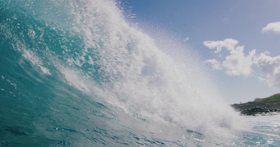 Powerful ocean wave breaking, deep blue wave barrel in warm tropical waters, blue planet Royalty-Free Stock Footage #1027016171