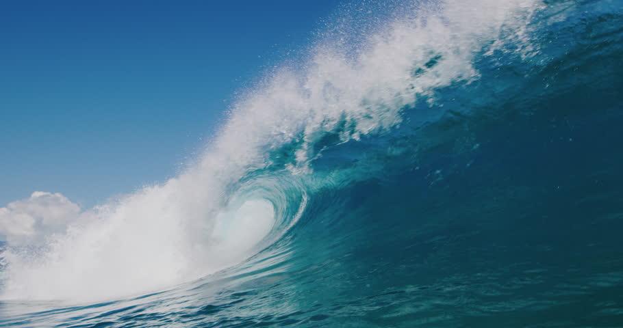 Powerful ocean wave breaking, deep blue wave barrel in warm tropical waters, blue planet