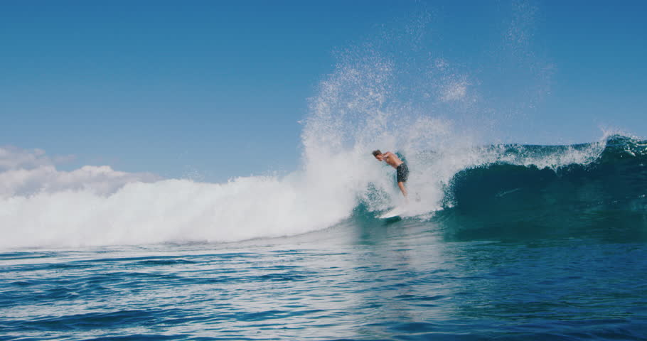 Surfer carving huge backside turn with spray on blue ocean wave, surfing ocean lifestyle, extreme sports, slow motion   Shutterstock HD Video #1027016195
