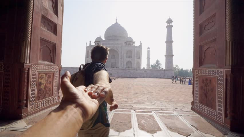 Follow me to concept: young man holding hand of girlfriend leading the way to beautiful temple in India - Personal perspective of girl giving hand to partner traveling together  | Shutterstock HD Video #1027024097