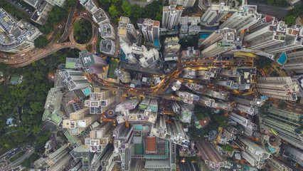 motion time lapse scene of huge building and road traffic transportation in day to night time at central area city in Hong Kong island urban area 4k video