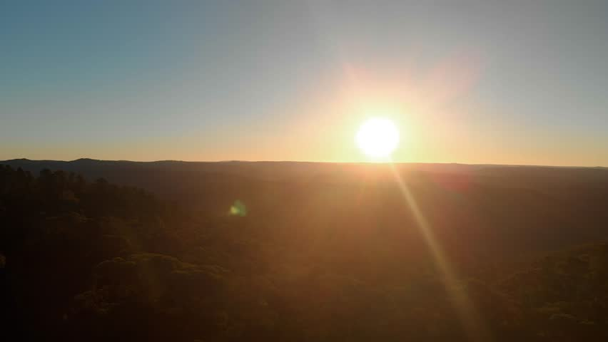 Aerial panoramic view of Blue Mountains (Sydney, Australia) at Sunset followed by the drone setting down behind eucalyptus trees on a hill | Shutterstock HD Video #1027034078
