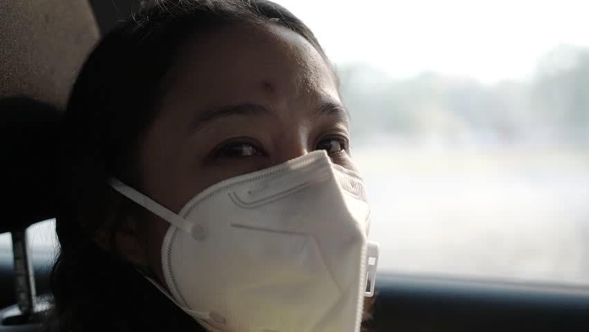 Asian Woman Wearing Pollution Protection Mask Unhealthy Air   Shutterstock HD Video #1027046492