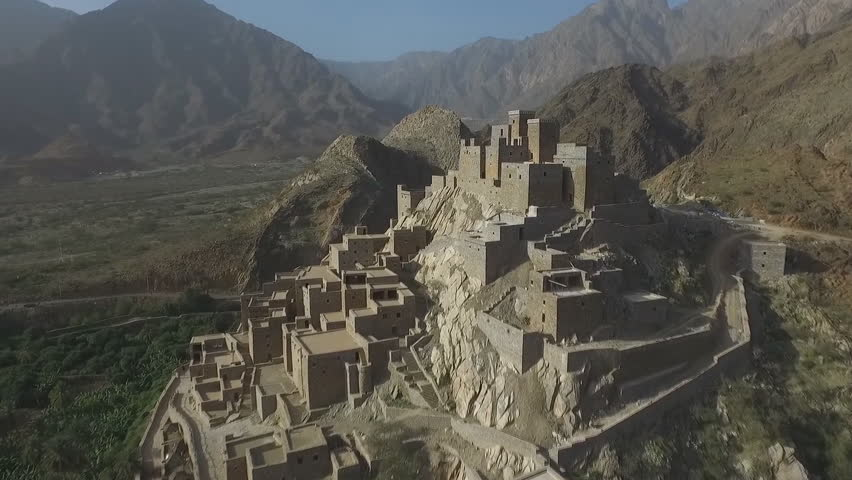 Dhy Ain Village, Al-Baha, Saudi Arabia. (aerial photography) about 20 kilometers from Manhwa and 24 kilometers from Bach. It originated in AH in the 10th century and lasts more than 400 years.  | Shutterstock HD Video #1027052276