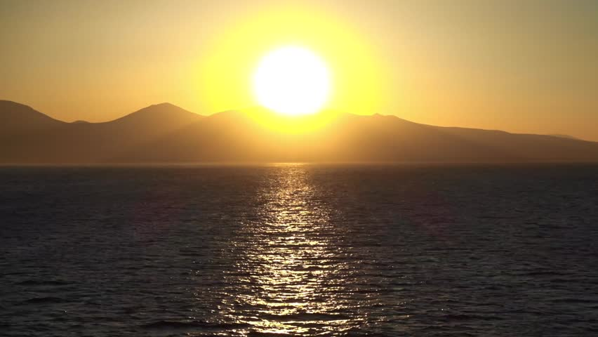 Beautiful sunset video over the Aegean sea video with calm sea as seen from passenger ship | Shutterstock HD Video #1027058531