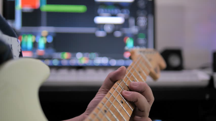Musician artist playing guitar to record in sound mixing studio process of music creation with dark and grain processed  | Shutterstock HD Video #1027066526