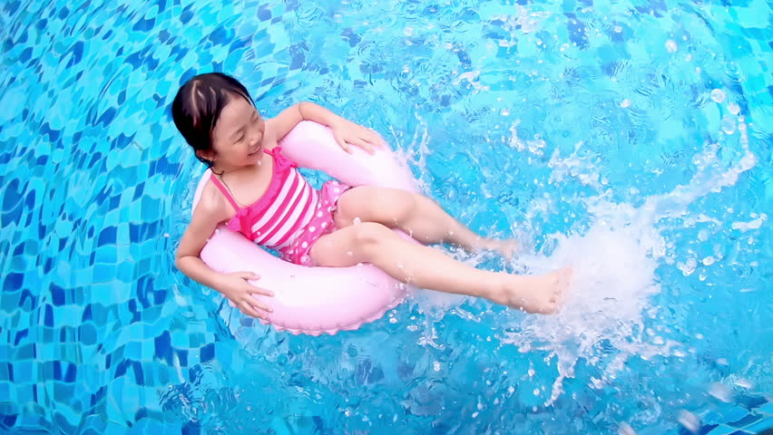 Cute girl play with floating ring in the swimming pool   Shutterstock HD Video #1027106618