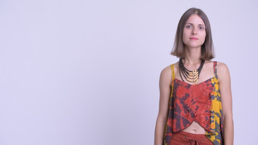 Happy young beautiful hipster woman touching something and crossing arms | Shutterstock HD Video #1027112051