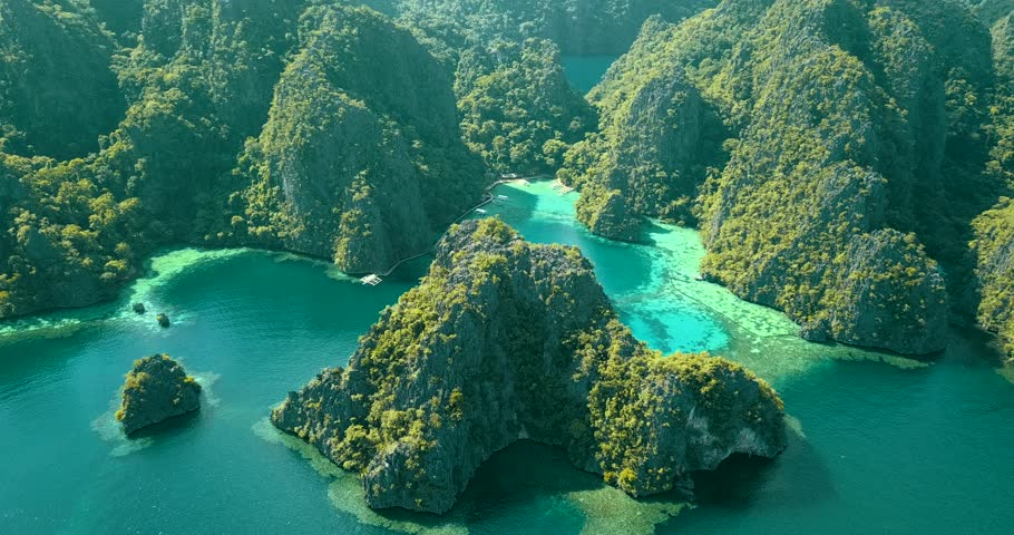Aerial view of turquoise tropical lagoon with Karst limestone cliffs in Coron Island, Palawan, Philippines. UNESCO World Heritage Tentative List.