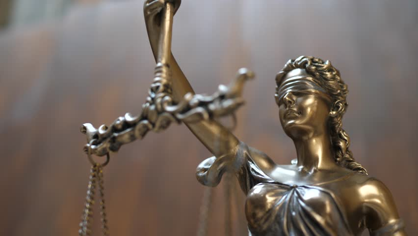 The Statue of Justice on Wooden Background. Concept of legal law, advice and justice | Shutterstock HD Video #1027133783