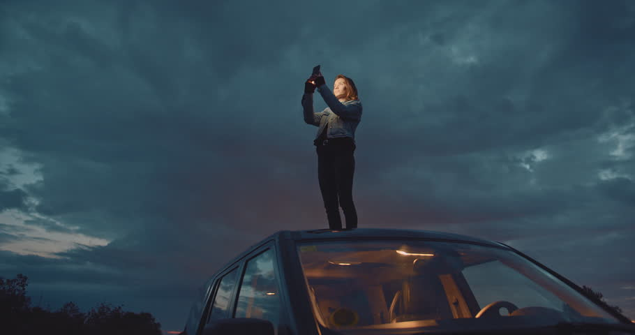 Hipster girl taking photos or sending text message on telephone during road trip, Slow Motion, Shot on Cine Camera 4K, Cinematic Shot | Shutterstock HD Video #1027149920
