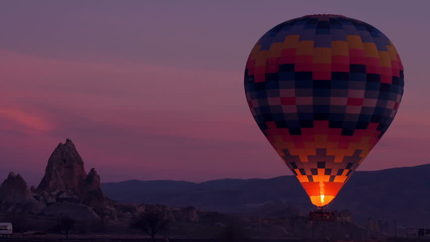 Close up Sunset hot air balloon ride scene. Hot air balloon basket sunset with fire flashing at early morning time.