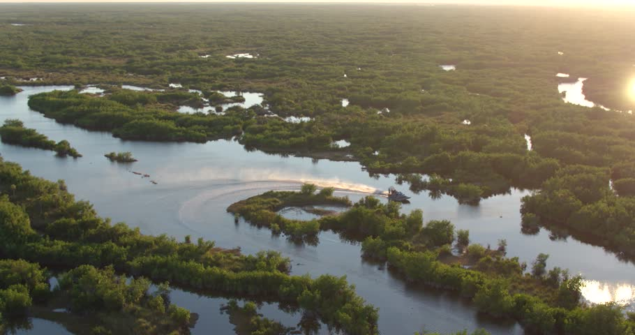 Airboat on Everglades at Sunset, Aerial Drone Slow Motion