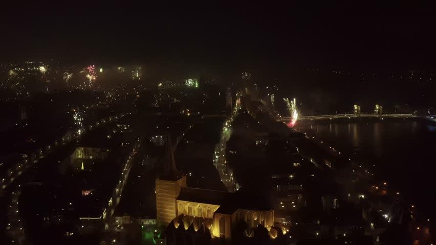 Fireworks besides and arround a church in Kampen | Shutterstock HD Video #1027171787