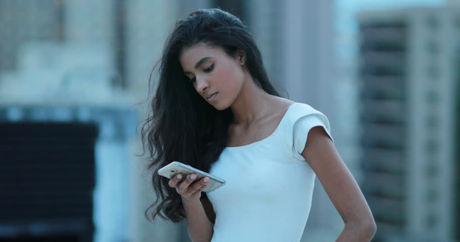 African girl holding smartphone device | Shutterstock HD Video #1027173293