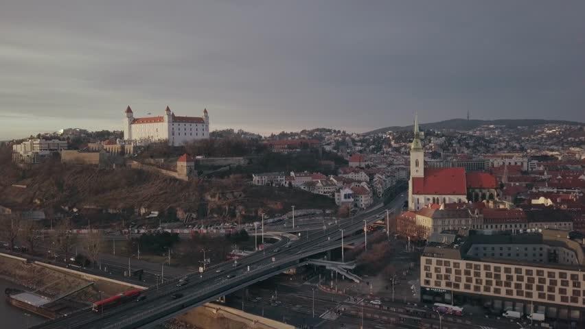 Aerial views across old town Bratislava castle landscape buildings & road bridge heading out of town to cross river Danube, Slovakia.   Shutterstock HD Video #1027173887