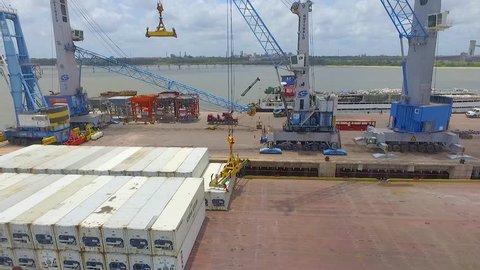 Rio Grande do Norte / Brazil - February - 2018: stacker Cranes unloading container from truck in a Port