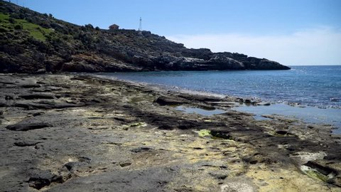 Antalya, Turkey - March 2019: Natural rock formations at Koru beach with people by the mediterranean sea, Gazipasa, Antalya province in Turkey