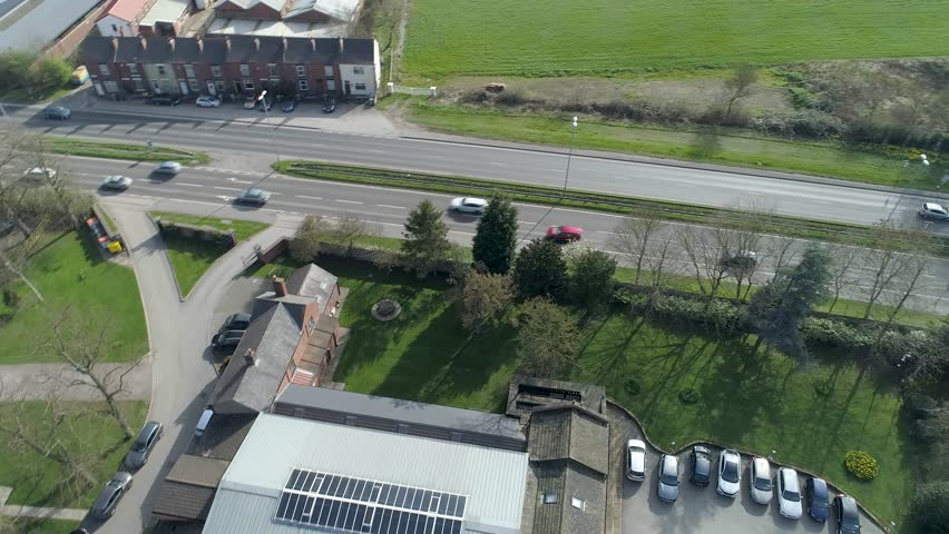 Aerial Drone view of main road revealing sunny fields, Leeds, Yorkshire, UK | Shutterstock HD Video #1027216601
