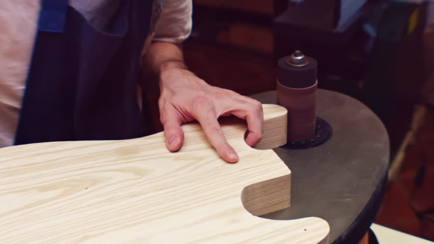Luthier professional sanding of electric guitar | Shutterstock HD Video #1027217579