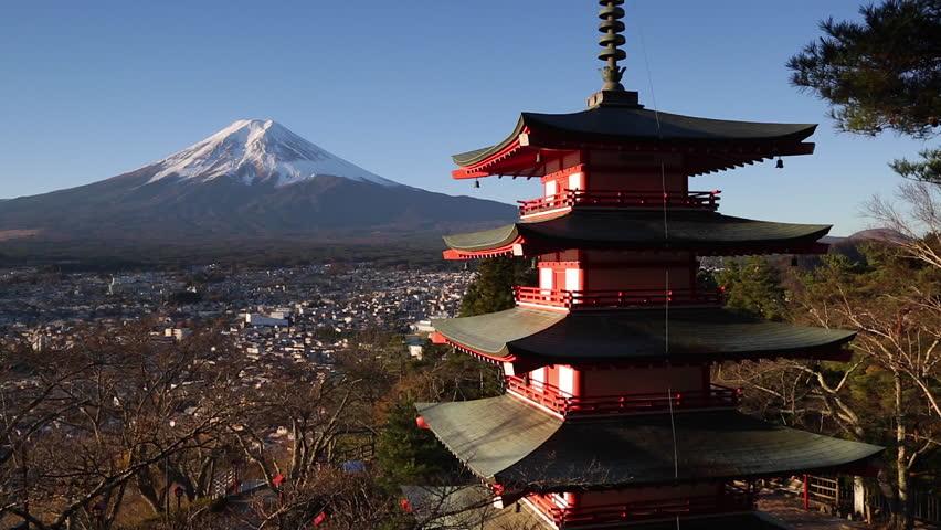 Fujiyoshida, Shizuoka, Honshu, Japan - CIRCA 2017: Snowy Mount Fuji and Chureito Pagoda at Arakura-yama Sengen-koen park, 4K | Shutterstock HD Video #1027219505