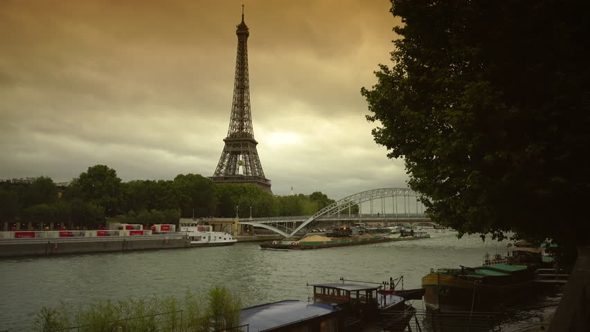 PARIS, FRANCE - circa 2019: Iconic Eiffel Tower Paris, Tourists Visit in Tour Boats on Seine River Trip French Travel cloudy day, real time   Shutterstock HD Video #1027223069