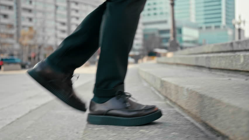 Close Up 4K Slow Motion Shot of Office Worker Man Walking Upstairs Outdoors in City. Male Feet in Suit and Platform Shoes Making Steps to Climb Up the Stairs