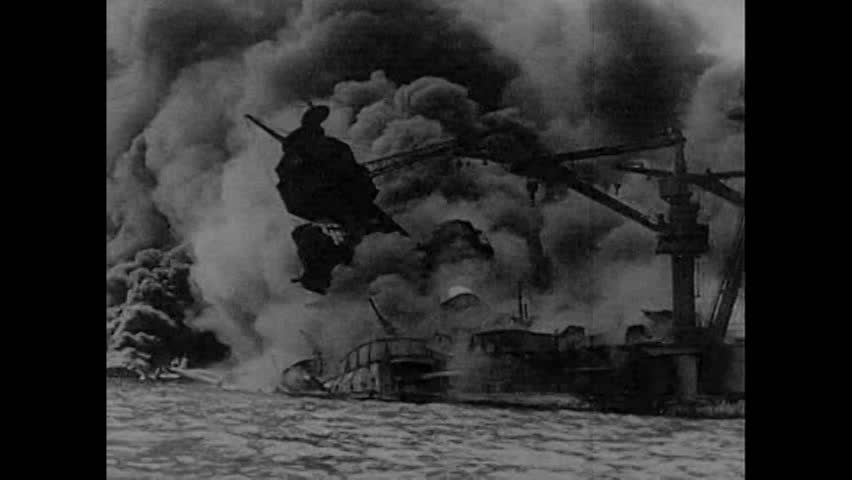 CIRCA 1941 - Ships are seen going up in smoke after the Pearl Harbor attack, as a narrator in 1963 explains Admiral Arleigh Burke's response to war.