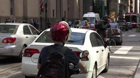 Toronto, Ontario, Canada June 2018 People On Bikes Cars And Transit Traffic in Toronto