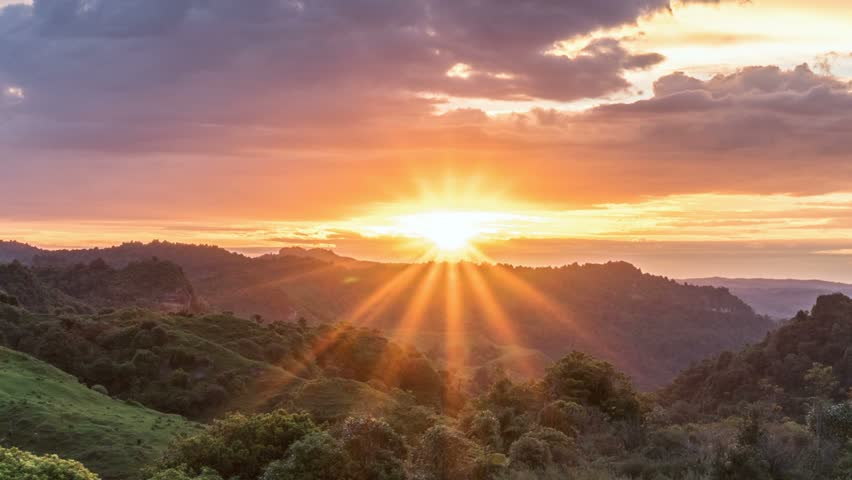 Beautiful sunrise over wild forest mountains in summer morning in New Zealand nature Time lapse