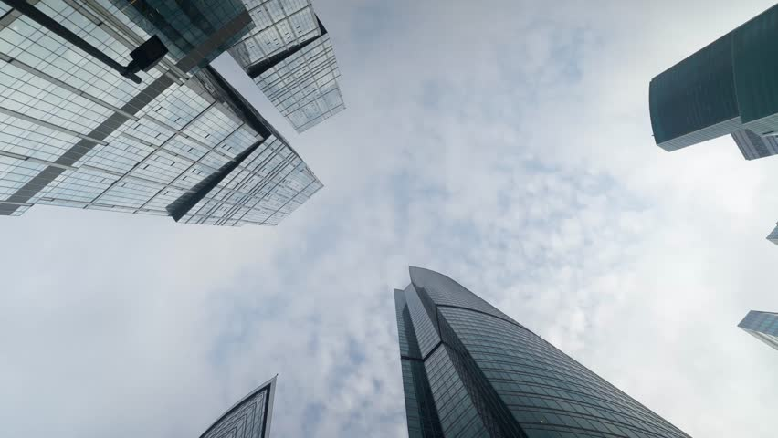 Bottom-up view of the skyscrapers and clouds in the business center Moscow City in Russia in the city of Moscow. Timelapse with rainy sky and dark clouds and skyscrapers. Skyscraper Time lapse | Shutterstock HD Video #1027300109