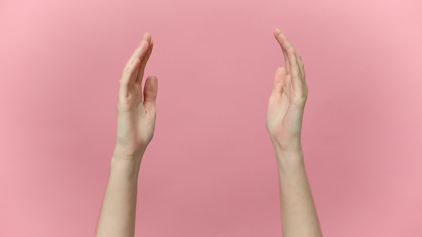 Woman hands arms clapping applause bravo showing two ok okay gesture isolated over pastel pink background in studio. Copy space for advertisement. With place for text or image Advertising area mock up