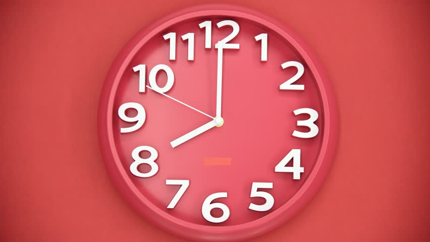 Time lapse of clock hanging on red wall
